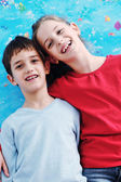 Portrait of happy brother and sister at home — Stock Photo