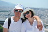 Happy young couple tourists in greece — Stock Photo