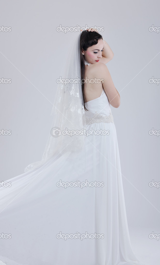 Beautiful young bride wearing  wedding dress in retro fashion style isolated on white background in studio — Stock Photo #8490768