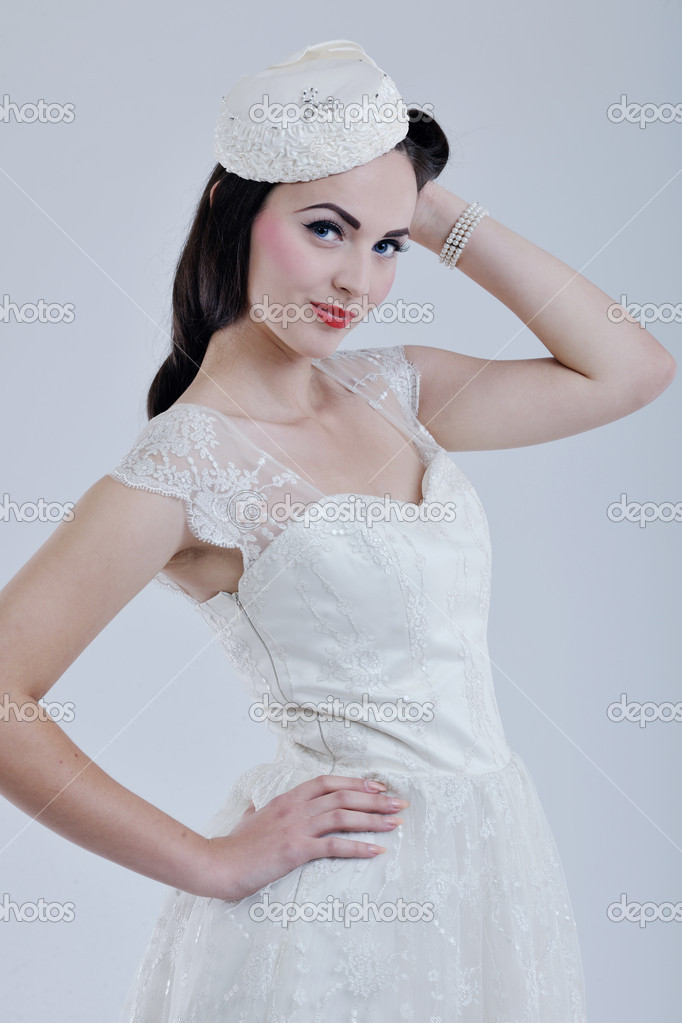 Beautiful young bride wearing  wedding dress in retro fashion style isolated on white background in studio — Stock Photo #8490790