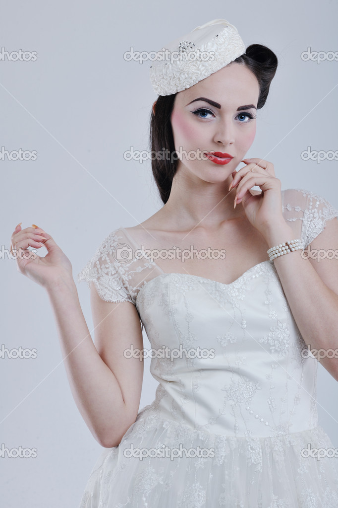 Beautiful young bride wearing  wedding dress in retro fashion style isolated on white background in studio — Stok fotoğraf #8490816