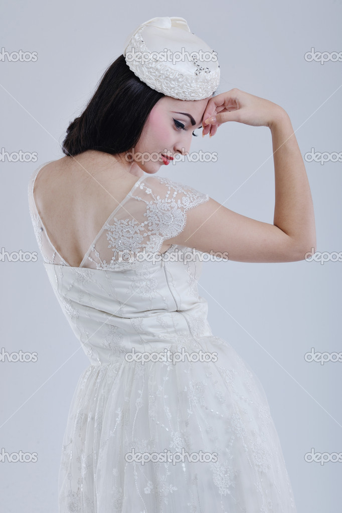 Beautiful young bride wearing  wedding dress in retro fashion style isolated on white background in studio — Stock Photo #8490824
