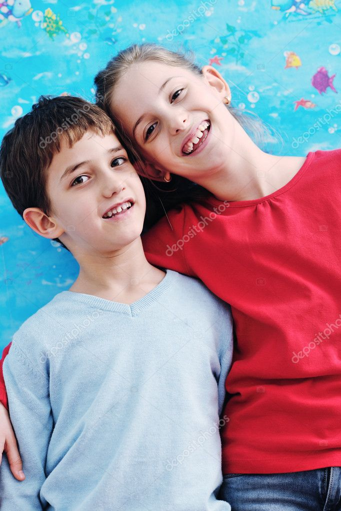 Happy child kids portrait at home brother and sister hug and have fun and joy  Stockfoto #8491737