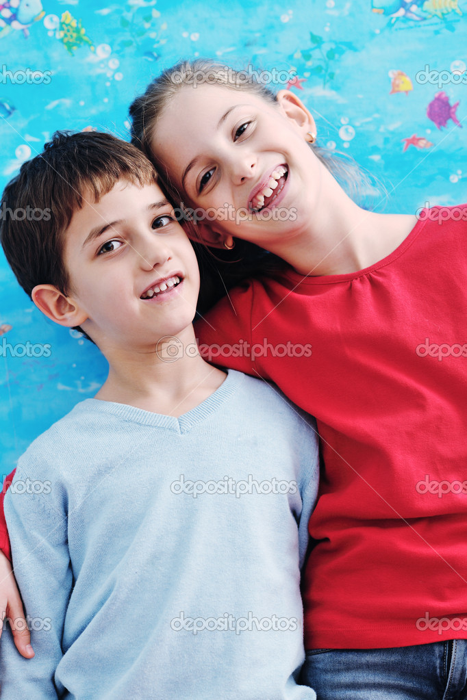 Happy child kids portrait at home brother and sister hug and have fun and joy  Foto Stock #8491737