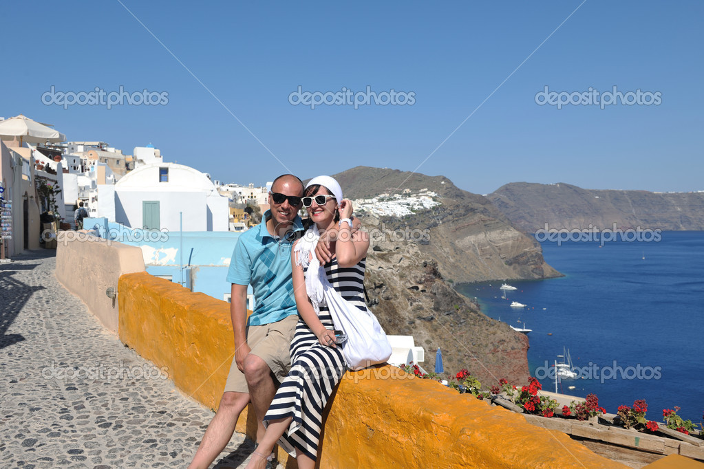 Young couple portrait in love have romantic time on summer vacation holidays in greece santorini — Stock Photo #8492977