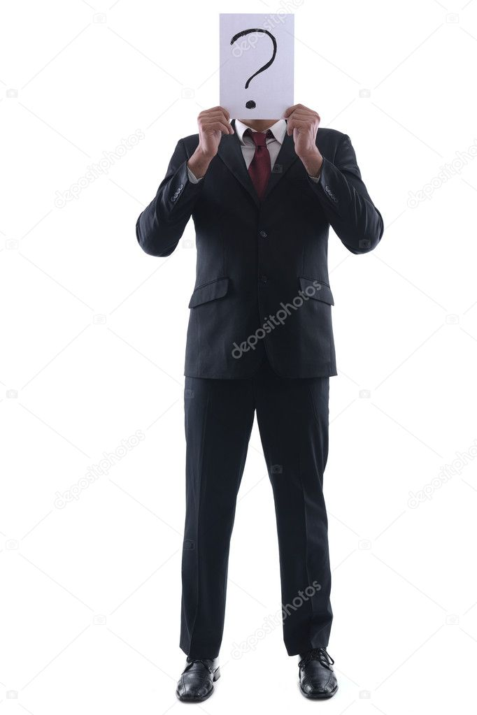 Business man holding a piece of paper over his face with a question mark on it isolated on white background in studio — Stock Photo #8981884