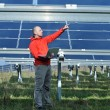 Engineer using laptop at solar panels plant field — Foto de Stock