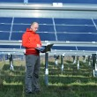 Engineer using laptop at solar panels plant field — Stock fotografie #8993969