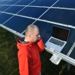 Engineer using laptop at solar panels plant field — Stock Photo