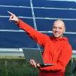 Engineer using laptop at solar panels plant field — Lizenzfreies Foto