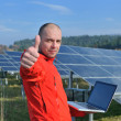 Royalty-Free Stock Photo: Engineer using laptop at solar panels plant field
