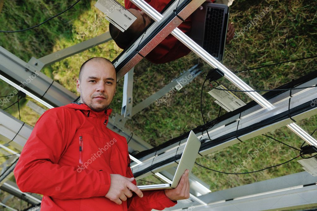 Business man  engineer using laptop at solar panels plant eco energy field  in background — Stock Photo #8994161