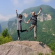 Happy young couple jumping in the air — Stock Photo #9141806