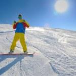 Skiing on fresh snow at winter season at beautiful sunny day — Stock Photo #9216885