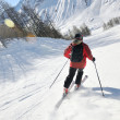 Skiing on fresh snow at winter season at beautiful sunny day — Stock Photo #9217068