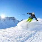 Skiing on fresh snow at winter season at beautiful sunny day — Stock Photo #9217413