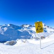 Sign board at High mountains under snow in the winter — Stockfoto #9219351