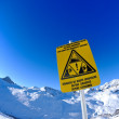Sign board at High mountains under snow in the winter — Stock Photo