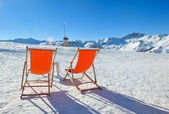 Wooden chair on top of mountaint — Stock Photo