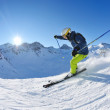 Skiing on fresh snow at winter season at beautiful sunny day — Stock Photo #9233069