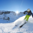 Skiing on fresh snow at winter season at beautiful sunny day — Stock Photo #9233071