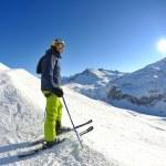 Skiing on fresh snow at winter season at beautiful sunny day — Stock Photo #9233073