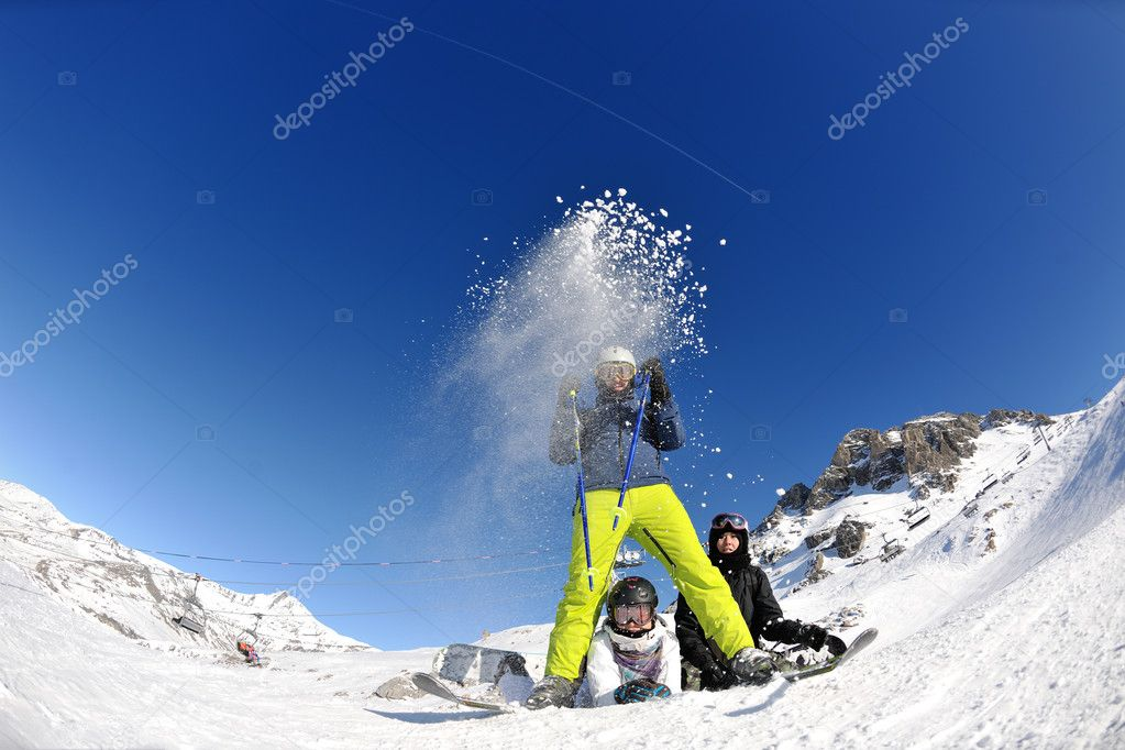 Happy group have fun on ski snow at winter season on mountain with blue sky and fresh air — Stock Photo #9233115