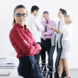 Business woman standing with her staff in background — Foto de Stock