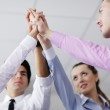Business group joining hands — Stock Photo