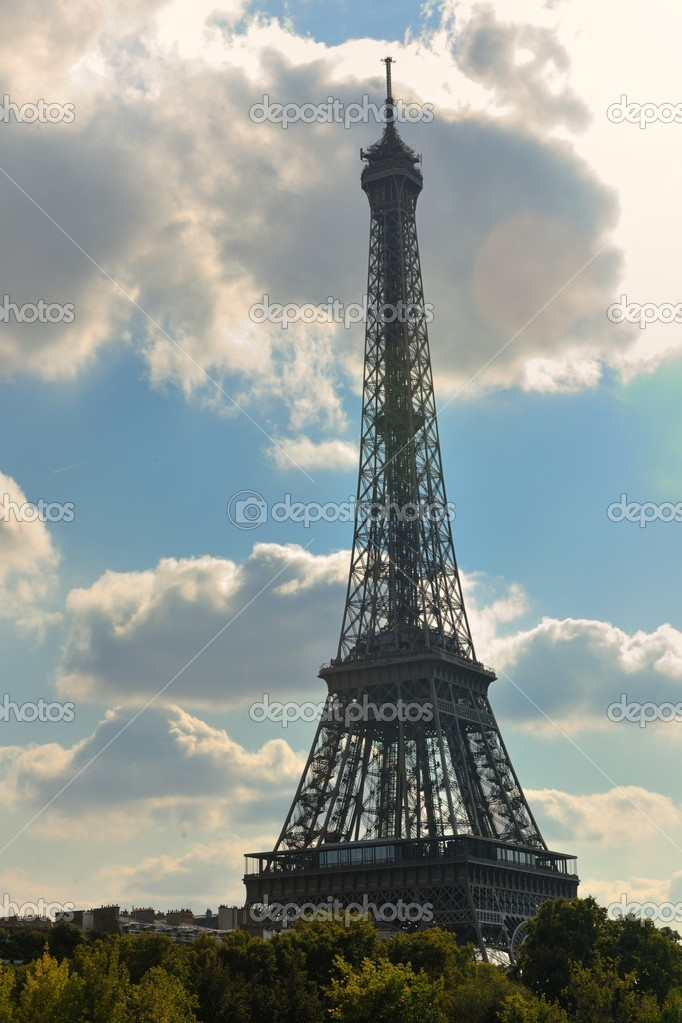 Eiffel Tower in Paris against a dramatic blue sky at day tourist and travel attraction — Stock Photo #9529424