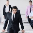 Young business man at meeting — Stock Photo #9567264