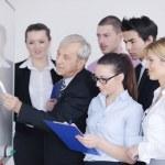 Senior business man giving a presentation — Stock Photo #9567641