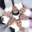 Business with their heads together — Stock Photo