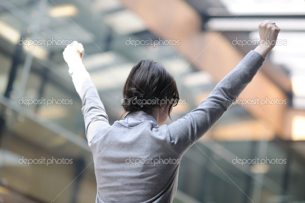 Business woman spread arms and representing freedom success and winner concept  Stock Photo #9669299