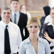 Business woman standing with her staff at conference — Stock Photo #9981715