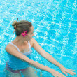 Girl in pool — Stock Photo