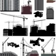 Set of isolated buildings and cranes - Stock Vector