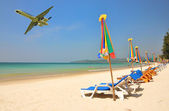 Row of sun beds at Bang Tao beach of Phuket island — Stock Photo