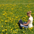 Girl with a laptop on the spring meadow — Stock Photo #8300025