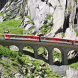 Alpine express passing bridge at St. Gotthard Pass in Switzerlan — Stock Photo