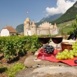 Red wine and grapes against Chateau d'Aigle castle. Switzerland — Stock Photo #8300233