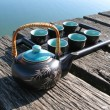 Chinese tea set on a wooden jetty — 图库照片