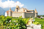 Wine, grapes and cheese against an old castle. Switzerland — Stock Photo