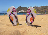 Flip-flops in the sand of Teresitas beach. Tenerife island, Cana — Stock Photo