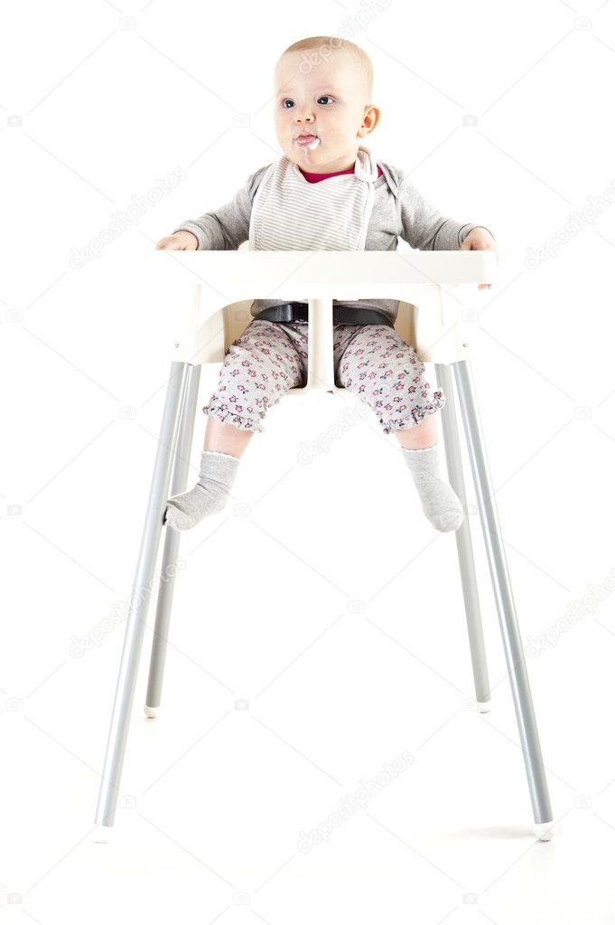 Baby in seat and eating — Stock Photo #10273215