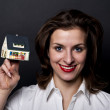 Woman with miniature house — Stock Photo #8049476
