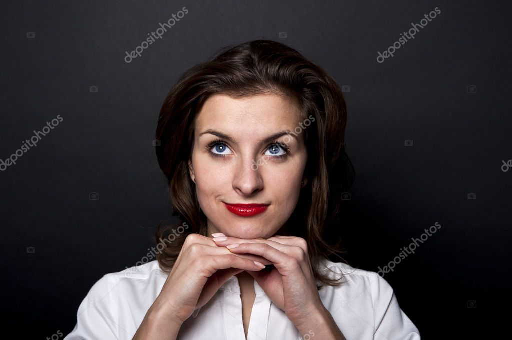 Woman with brown hair on black background — Stock Photo #8049489