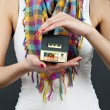 Woman with miniature house on black background — Stock Photo #9757520