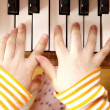 Stock Photo: Close up of child's hands playing piano