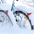 Bicycle covered by white snow — Stock Photo